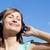 donna · ascolto · musica · outdoor · cielo · blu - foto d'archivio © wavebreak_media
