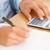 Feminine hands using a pen and a calculator in an office stock photo © wavebreak_media