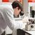 jonge · wetenschap · student · naar · microscoop · laboratorium - stockfoto © wavebreak_media