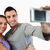 Young couple taking photograph of themselves against a white background stock photo © wavebreak_media