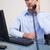 серьезный · глядя · молодые · бизнесмен · телефон · работу - Сток-фото © wavebreak_media