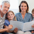 счастливая · семья · чтение · книга · вместе · гостиной · любви - Сток-фото © wavebreak_media