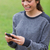 Young girl showing a beaming smile while sending a text with her mobile phone stock photo © wavebreak_media