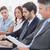 business team looking at laptop stock photo © wavebreak_media