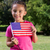 little girl waving american flag stock photo © wavebreak_media