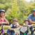 gelukkig · gezin · fiets · park · voorjaar · man - stockfoto © wavebreak_media