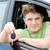 Animated caucasian man holding a car key sitting in his car stock photo © wavebreak_media