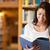 diák · könyvtár · boldog · nő · tart · könyv - stock fotó © wavebreak_media