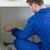 Focused repair man measuring something in a kitchen stock photo © wavebreak_media