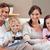 souriant · famille · jouer · jeux · vidéo · ensemble · salon - photo stock © wavebreak_media