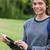 jungen · lächelnd · Mädchen · Tablet-Computer · stehen · Park - stock foto © wavebreak_media