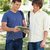 Two smiling male students with a touch pad in a park stock photo © wavebreak_media