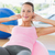 smiling woman exercising on fitness ball at gym stock photo © wavebreak_media