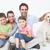 szczęśliwą · rodzinę · uśmiechnięty · kamery · psa · drzewo - zdjęcia stock © wavebreak_media