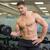 shirtless bodybuilder lifting heavy black dumbbell looking at ca stock photo © wavebreak_media