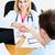 amigável · feminino · médico · aperto · de · mãos · paciente · sessão - foto stock © wavebreak_media