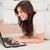 aantrekkelijk · brunette · vrouw · ontspannen · laptop · tapijt - stockfoto © wavebreak_media