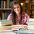 gülen · öğrenci · okumak · kütüphane · kadın · kitap - stok fotoğraf © wavebreak_media