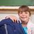 glimlachend · schoolmeisje · poseren · zak · klas · meisje - stockfoto © wavebreak_media