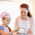 cheerful mother and daughter preparing dough together stock photo © wavebreak_media