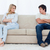 A angry couple sit at the two ends of the couch with their arms folded looking at each other stock photo © wavebreak_media