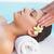 tranquil brunette getting a head massage poolside stock photo © wavebreak_media