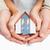 couple holding small model house in hands stock photo © wavebreak_media