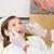 Pediatric dentist examining a patients teeth in the dentists cha stock photo © wavebreak_media