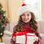 kleines · Mädchen · Öffnen · Weihnachten · vorliegenden · Couch · Familie - stock foto © wavebreak_media