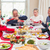 family pulling christmas crackers at the dinner table stock photo © wavebreak_media