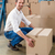Smiling warehouse manager with box stock photo © wavebreak_media