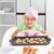 feliz · little · girl · prato · bolinhos · pronto - foto stock © wavebreak_media