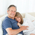 Senior couple lying down on their bed at home stock photo © wavebreak_media