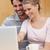 feliz · expectante · casal · usando · laptop · cozinha · casa - foto stock © wavebreak_media