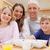 улыбаясь · семьи · завтрак · кухне · дома - Сток-фото © wavebreak_media