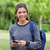 Young smiling woman looking straight at the camera while using her mobile phone stock photo © wavebreak_media