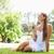 jonge · vrouw · vergadering · gras · park · bloem · schoonheid - stockfoto © wavebreak_media