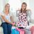 пару · улыбаясь · девочек · новых · одежды · диване - Сток-фото © wavebreak_media