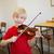 cute pupil playing violin in classroom stock photo © wavebreak_media