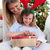 portrait of a mother and her daughter unpacking christmas gifts stock photo © wavebreak_media