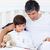 отец · чтение · сын · сидят · кровать - Сток-фото © wavebreak_media