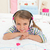 Cute little gril listening to music lying on her bed stock photo © wavebreak_media
