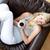 encantador · mujer · potable · café · sesión · sofá - foto stock © wavebreak_media