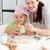 menina · feliz · mãe · pequeno · bolos · cozinha - foto stock © wavebreak_media
