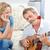 romántica · hombre · jugando · guitarra · esposa · casa - foto stock © wavebreak_media