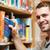 gülen · erkek · öğrenci · kitap · kütüphane - stok fotoğraf © wavebreak_media