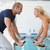 side view of couple working on exercise bikes at gym stock photo © wavebreak_media