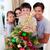 happy family decorating a christmas tree stock photo © wavebreak_media