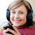 Delighted woman is listening the music in the living-room  stock photo © wavebreak_media