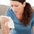 nervous woman looking at a bill while doing her accounts at home stock photo © wavebreak_media